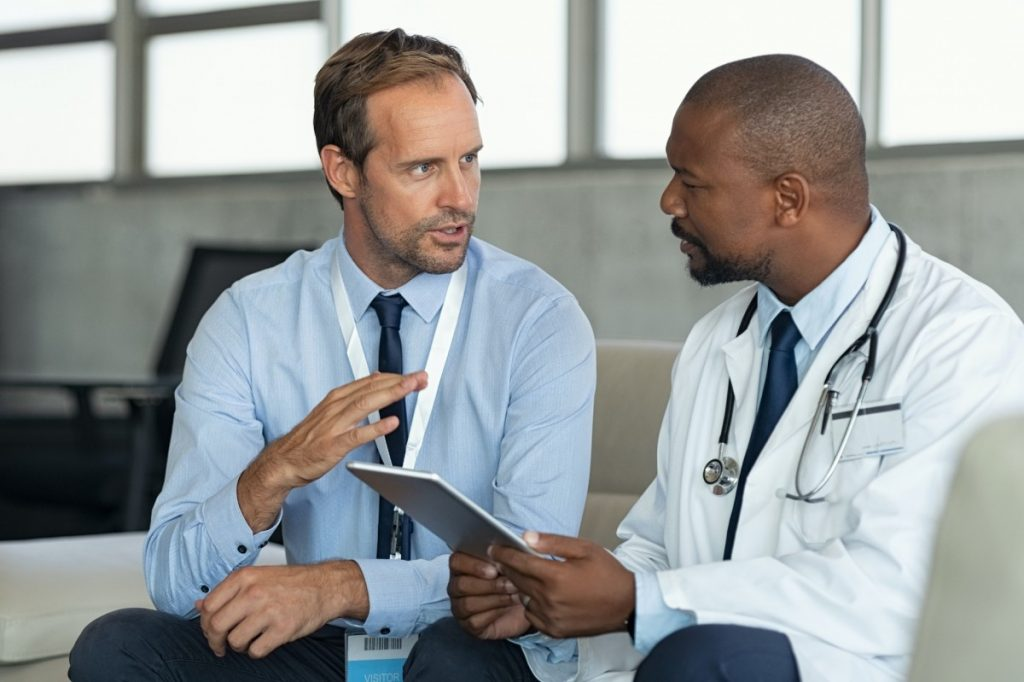 tax account explaining investment options to a doctor