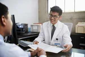 happy doctor with tax accountant